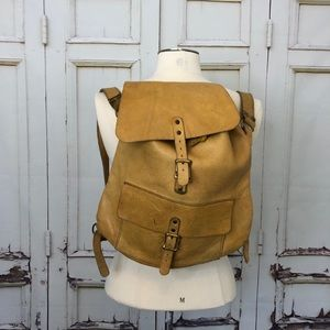 Vintage leather backpack camel buckle straps bag